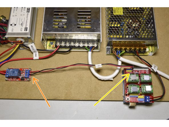 Connect the Relay Signal cable to the IN port on the relay (red cable) and to the DC- port on the relay (black cable)