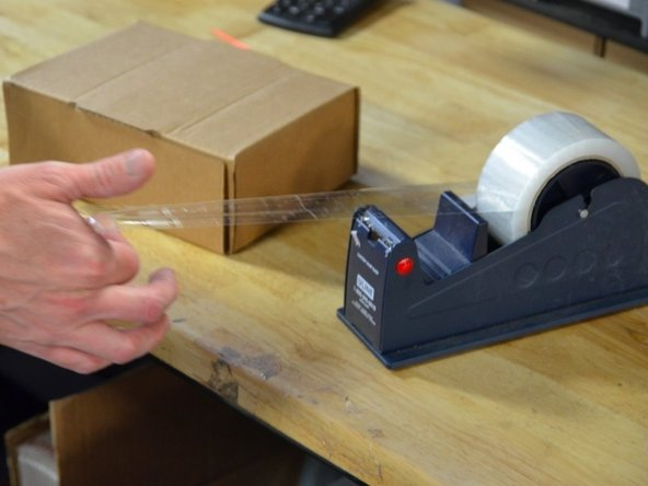 Pull the tape away from the dispenser using your thumb and pointer finger.