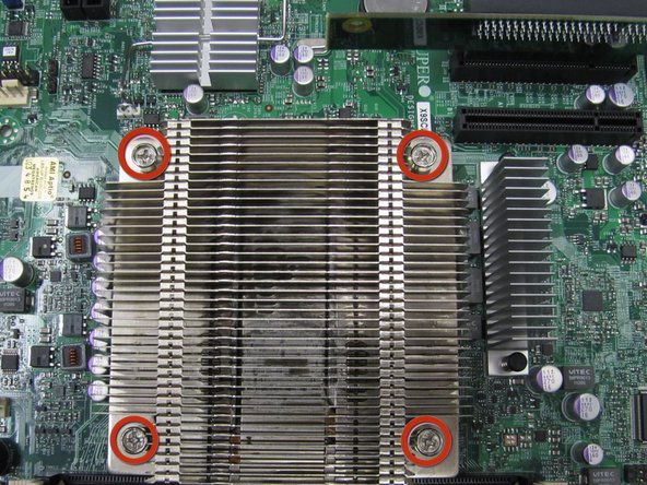 Place the heatsink on top of the CPU and fasten it to the retention bracket.