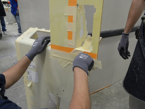 Begin bonding the smaller subassemblies and covering each of the joints with masking tape.