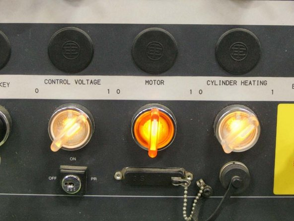 """Turn on """"Motor"""" by rotating the button clockwise and releasing it.  There may be a delay of a few seconds before the lamp glows. CAUTION: Do not attempt to move or rotate the screw until the cylinder heats have reached the appropriate set point and have been allowed to stabilize for 15-20 minutes."""
