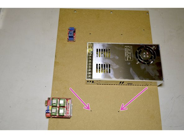 Mount the 100W power supply through the holes indicated in pink.