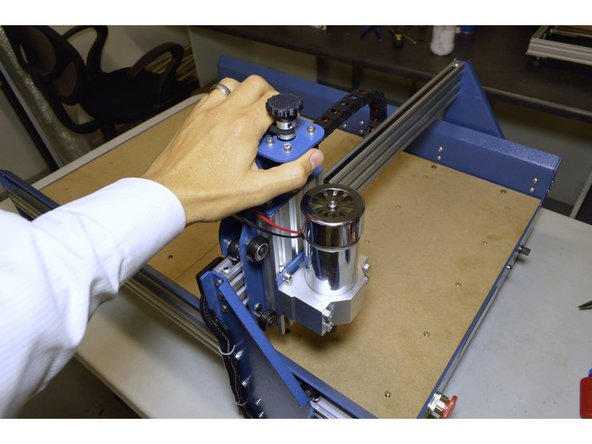 Move the X-Axis slowly back and forth to make sure it can move smoothly and nothing is obstructing the movement