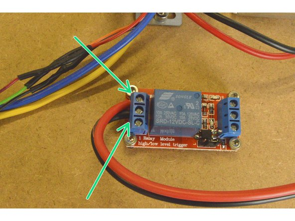 Take the Relay COM Cable and connect the end without the crimp terminal to the relay.  The red cable needs to be connected to the NO port and the black cable to the COM port as shown.