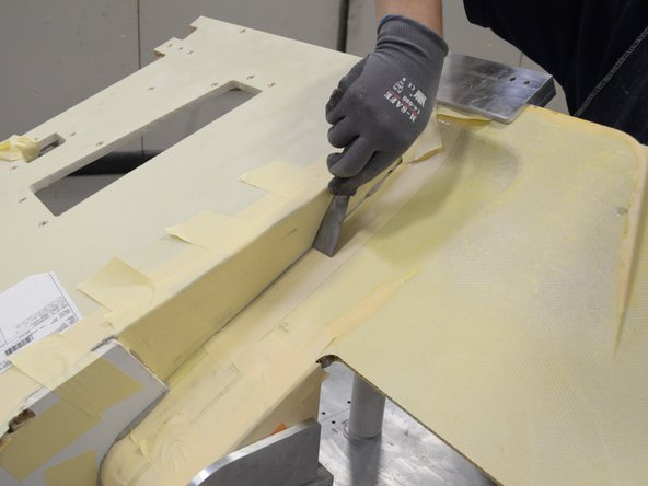 Clean all visible joints of excess adhesive and cover them with masking tape.