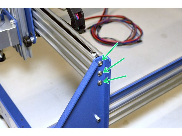 Insert the X-Axis Assembly in-between the Left and Right side plates with the spindle facing the Front Frame Plate