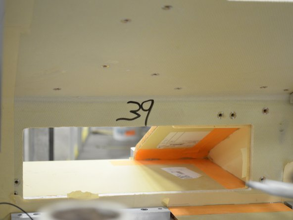 Mark the seat console assembly with the appropriate batch number.