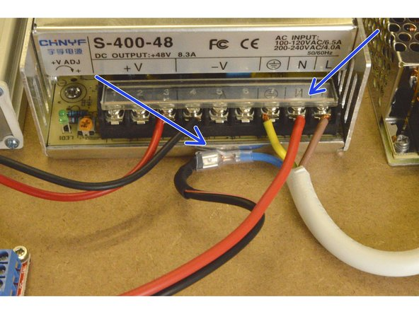 Connect the other end of the Relay COM cable to the 400W power supply by connecting the red cable to the N port and the black cable to the crimp terminal on the blue 220V cable as shown.