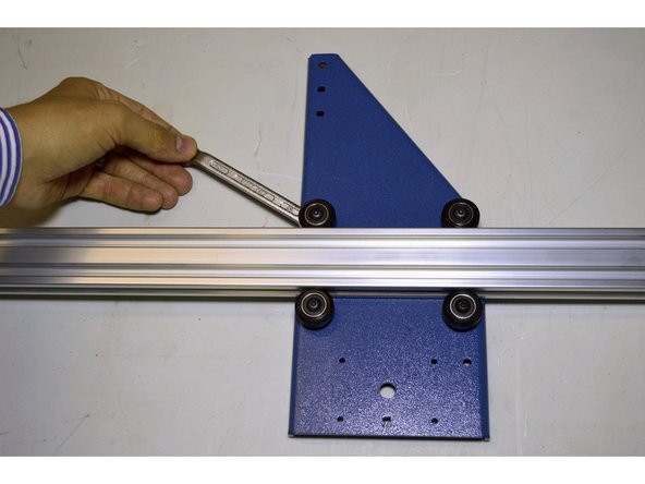 Slide the 20x40 V-slot profile in between the V-wheels