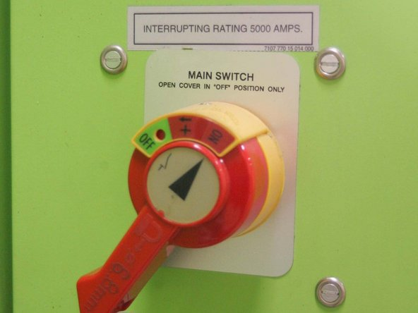 "Turn on machine power by rotating the lever to the ""on"" position."