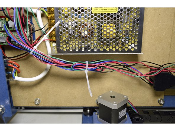 Tie cables down as shown in the pictures