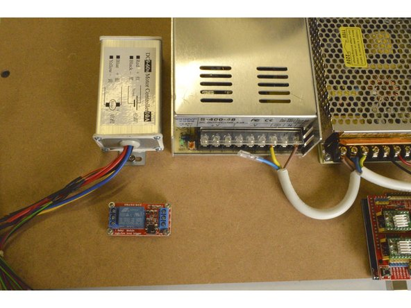Mount the Spindle Speed Controller as shown with the M4x8 Cap Screws (2 Pcs) and the M4 Lock Nuts (2 Pcs)