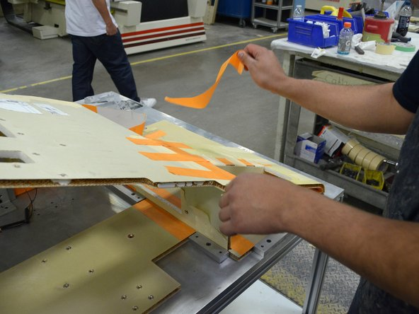 Remove only the pieces of tape that hold the pieces of the assembly together.