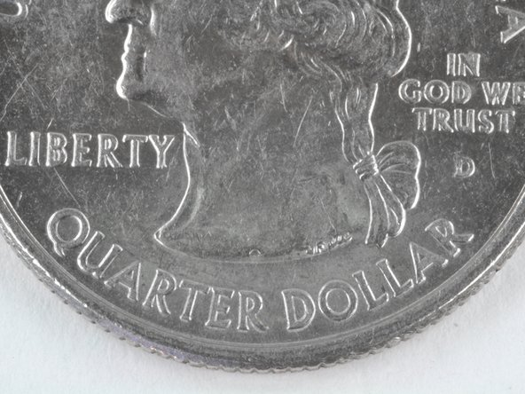 Look at all the scratches on George Washington's neck! There's no way this quarter is still worth 25¢.