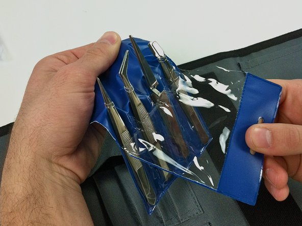 For the pack of tweezers, pull the clear plastic front away from the plastic backing.