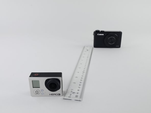 Image 2: f-stop of 8. The Canon camera is now more in focus, as are parts of the ruler.
