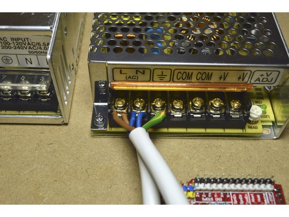 Connect the 220V Power Cable and the 220V Bridge Cable to the 100W Power Supply as shown in the picture