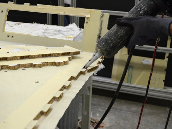 Place a strip of masking tape underneath each bonding surface to catch the adhesive.
