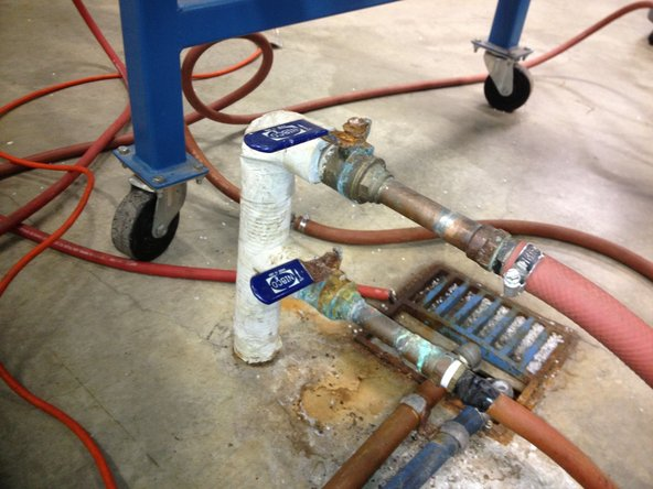 Turn on main water supply, ball valve on the floor, near injection end of machine.