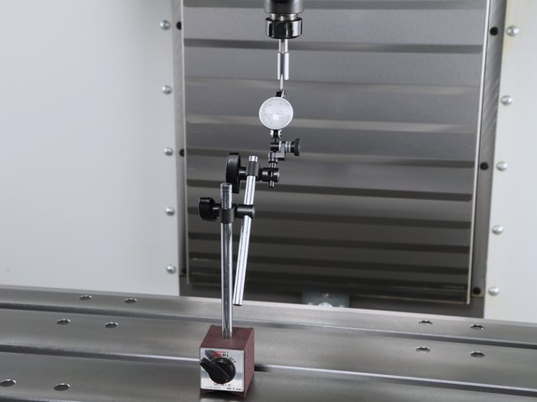 Using the Z-axis and an indicator, check the distance from the face of the spindle to the tip of the gauge pin.