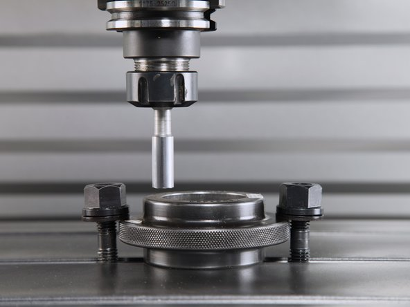 With the calibration bar in the spindle, position the pin above the edge of the ring gauge.