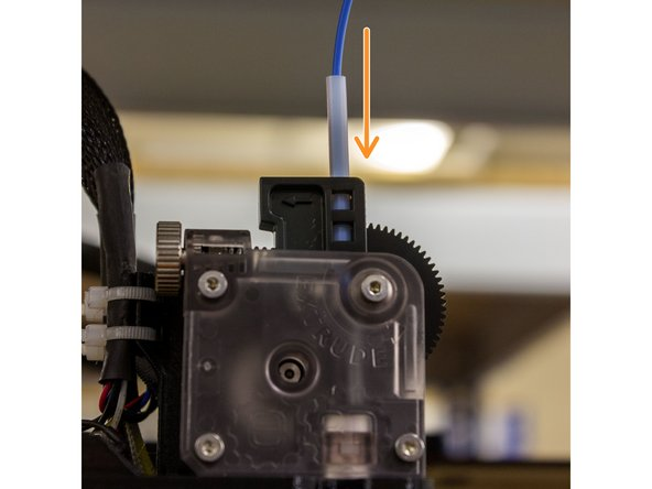Load filament into your extruder, just until it is gripped by the drive shaft (you can't pull it out without moving the large gear turning)