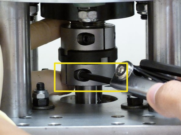 Loosen the coupling bottom piece by loosening the hexagonal socket head screw with an s4 Allen key as shown