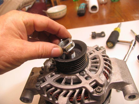 Loosen and remove pulley nut