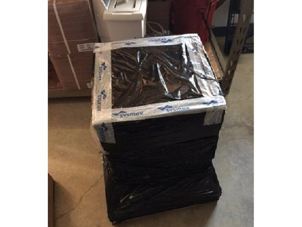 The Ploidy Analyzer is shipped in a cardboard box that is attached to a wooden pallet with a plastic wrap.