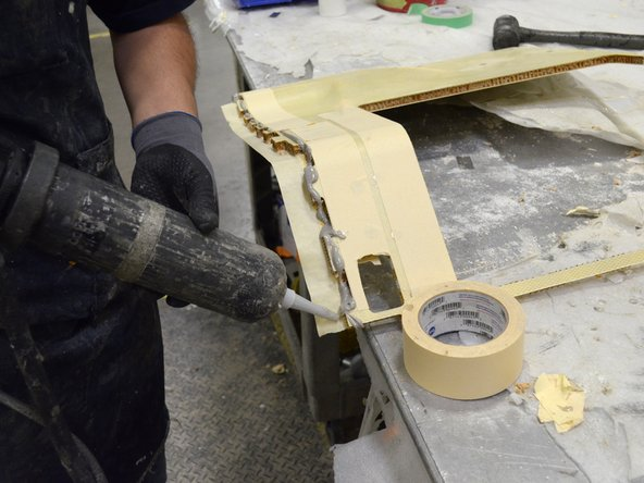Install the second half of the top of the seat console assembly.
