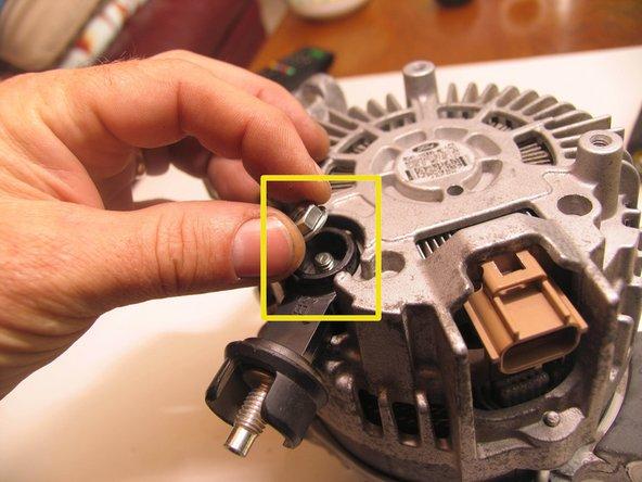 Loosen and remove retaining nut