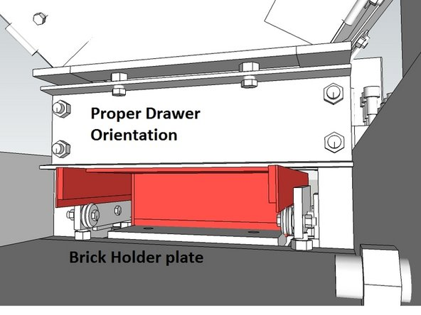 Insert the drawer into the chamber as shown, in the fully retracted position. Its important that it be in the right orientation.