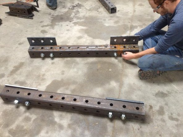 Take two 12-hole steel tubes.  These will be used to mount the Quick Attach.