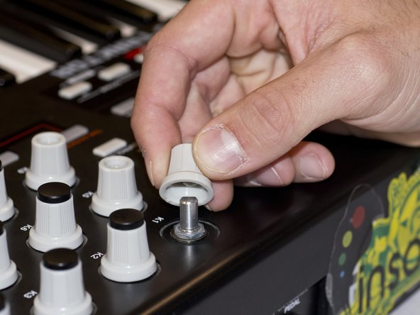Remove all the selector knob covers by pulling them off.