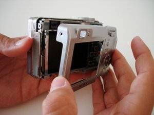 Disassembling Sony Cyber-shot DSC-W5 Back Cover