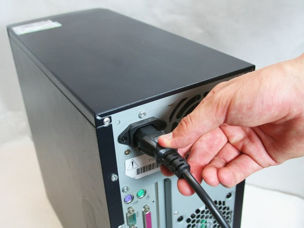 Turn off your computer and remove the power cable by pulling it straight out of its socket.
