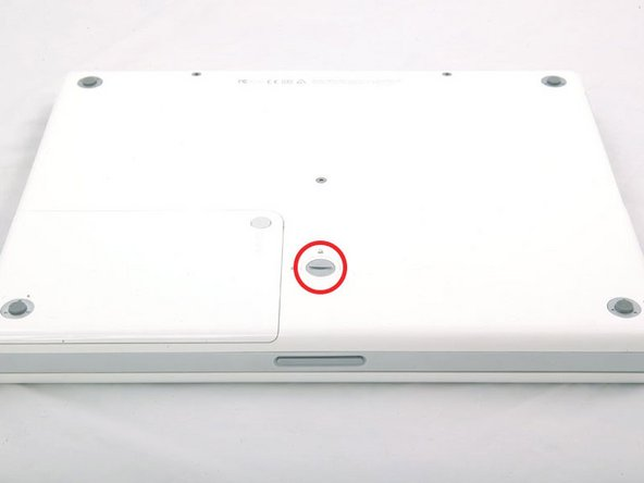 Use a coin to rotate the battery locking screw 90 degrees clockwise.